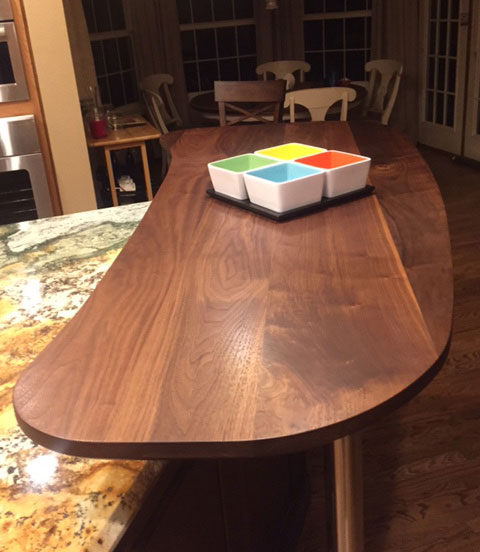 wide plank walnut countertop with everlast varnish finish by armani fine woodworking